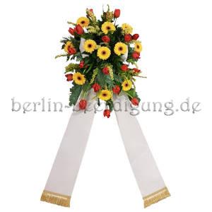 Blumengesteck zur Beerdigung gelbrot