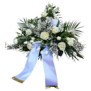 Aufwändiges Blumengesteck zur Bestattung in Weiß mit Schleife
