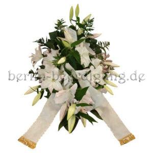 Trauergesteck aus weißen Lilien mit weißem Schleifenband